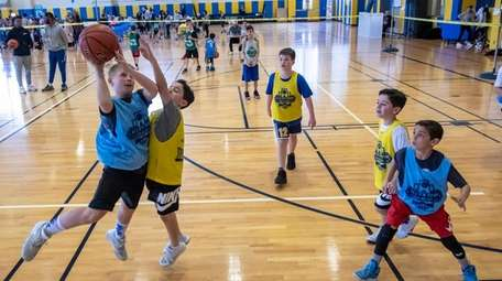 Participants play a game of basketball at the