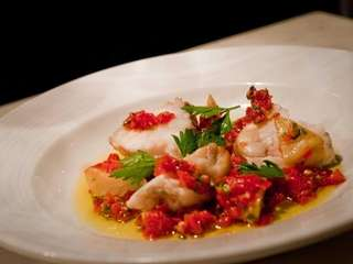 Monkfish roasted with sweet peppers, artichokes and spicy