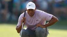 Tiger Woods lines up his putt on the