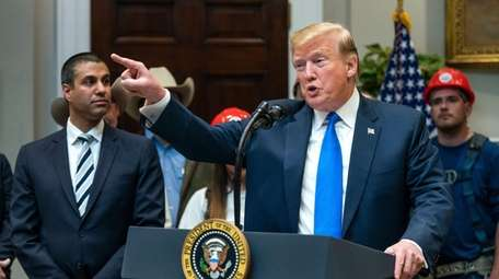 President Donald Trump, along with Federal Communications Commission