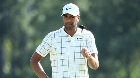 Tony Finau reacts on the 18th green during