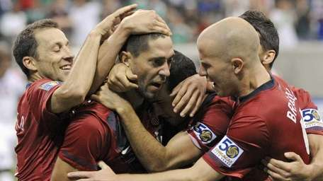 United States' Clint Dempsey, center, is congratulated by