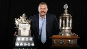 Tim Thomas of the Boston Bruins poses after