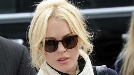 Lindsay Lohan arrives for a preliminary hearing in
