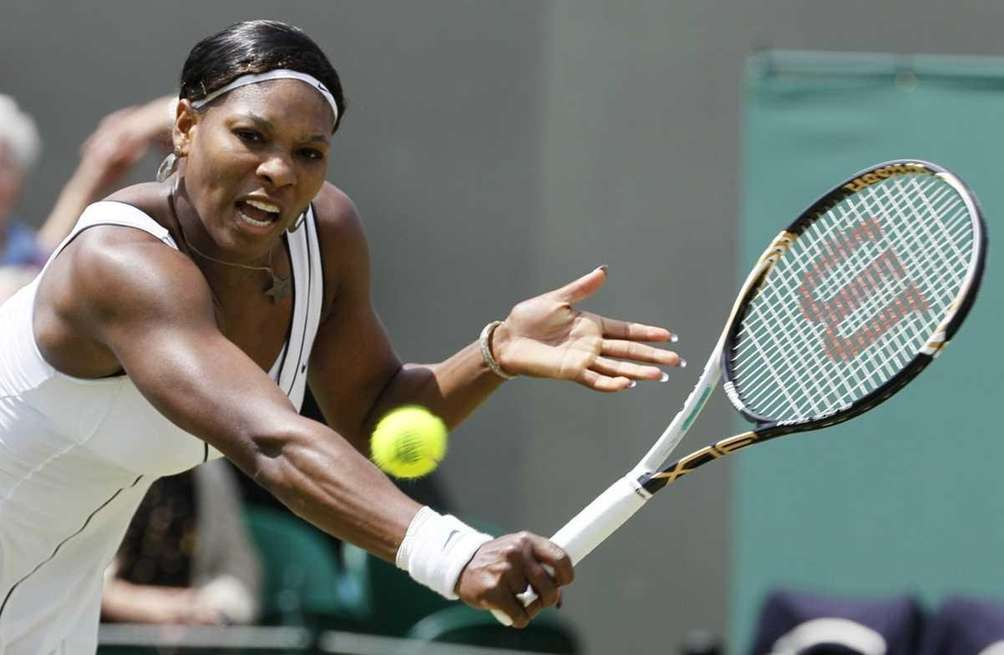 Serena Williams returns a shot to Romania's Simona