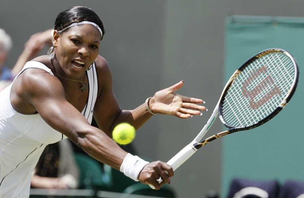 Serena Williams returns a shot to Romania's Simona