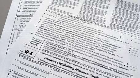 This photo shows an IRS W-4 form on