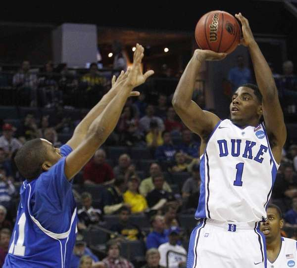 Duke guard Kyrie Irving, shooting over Hampton guard