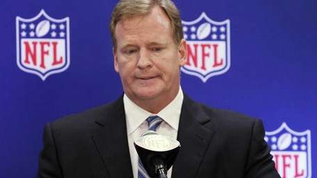 NFL Commissioner Roger Goodell listens to questions during