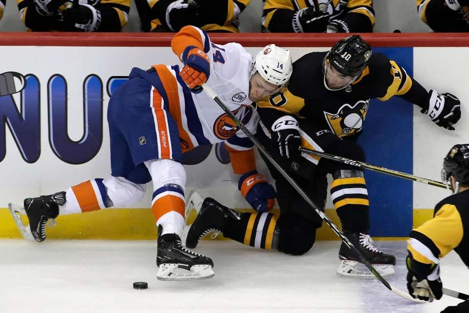 Pittsburgh Penguins' Garrett Wilson, right, collides with New