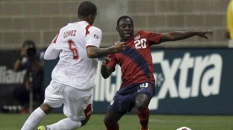 Freddy Adu of the United States attempts to