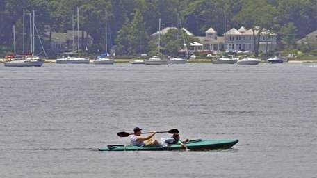 A kayaker and passenger take to the waters
