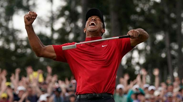 Tiger Woods reacts as he wins the Masters