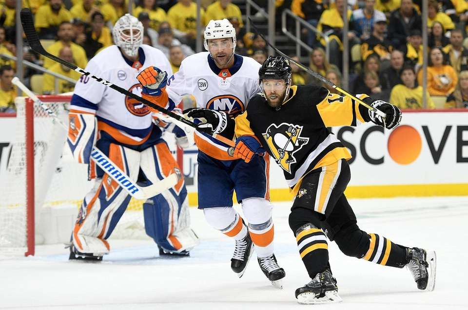 Bryan Rust #17 of the Pittsburgh Penguins battles