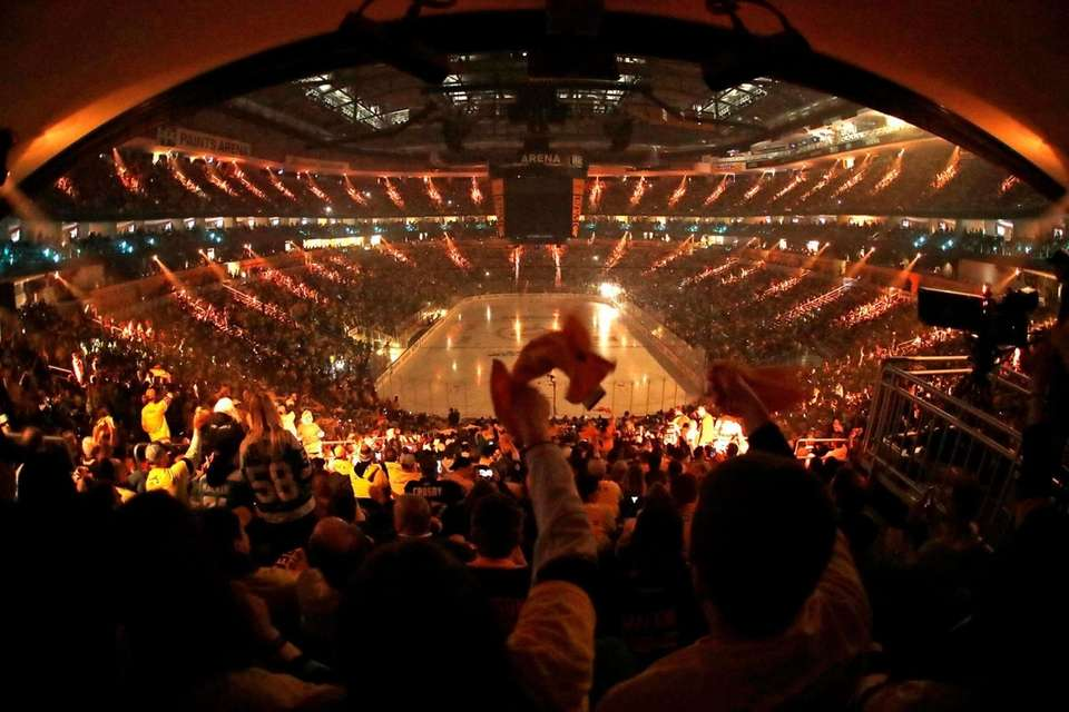 Pittsburgh Penguins fans wave towels during a laser