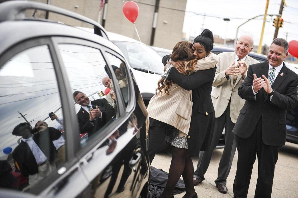 Veteran Karen Jones, of Hempstead, hugs Jordan Daiagi