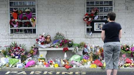 Mourners pay their respects at Haven Drugs pharmacy