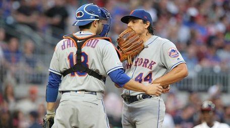 Mets pitcher Jason Vargas talks to catcher Travis