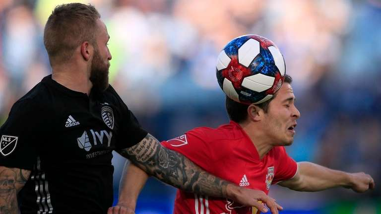 Red Bulls defender Connor Lade, right, heads the