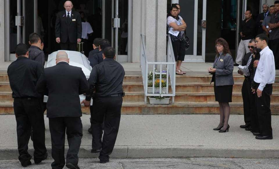 Family members watch as Jennifer Mejia's coffin is
