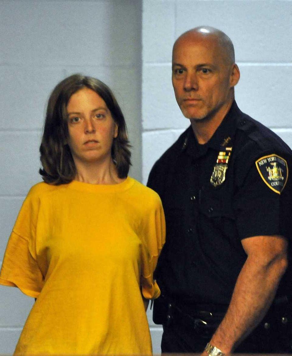 Melinda Brady, wife of David Laffer, is brought