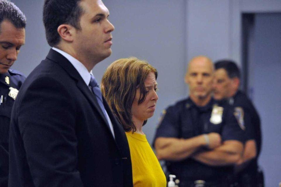 Melinda Brady, wife of David Laffer, stands with