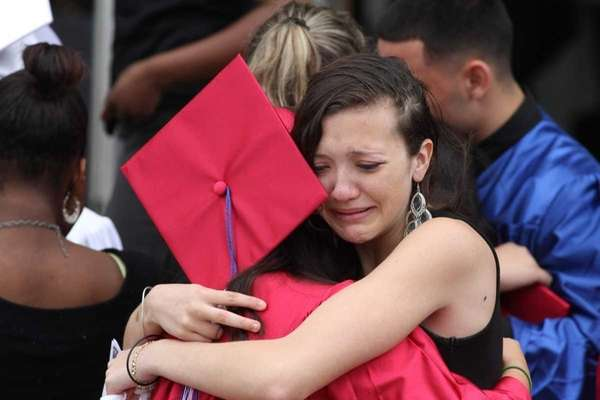 Classmates of Jennifer Mejia embrace outside of Our