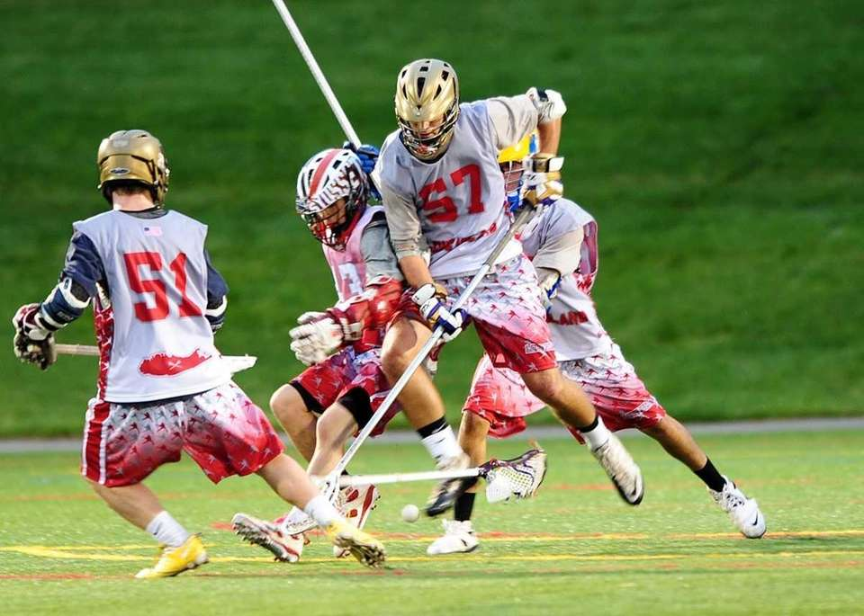 Islip's Terence Foley (57) battles Syosset's Ryan Hunter