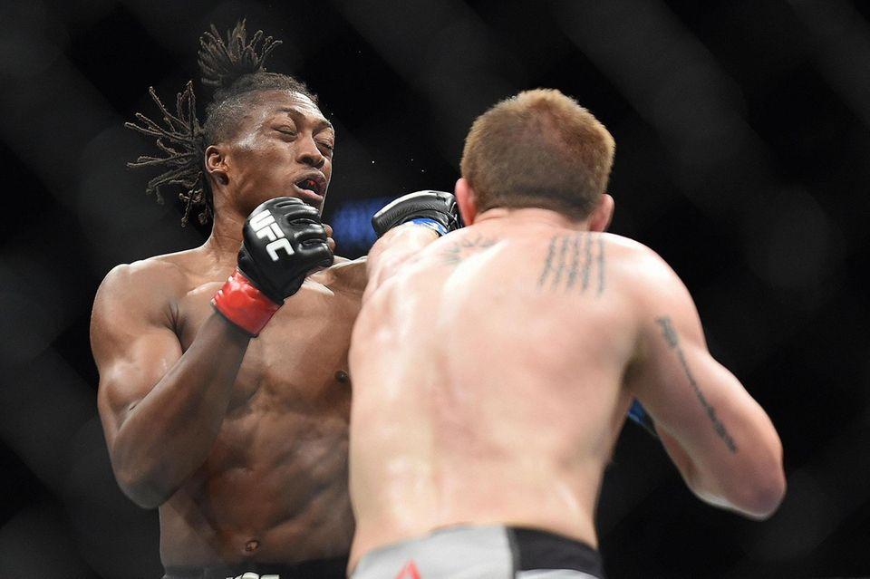 Matt Frevola punches Jalin Turner during the UFC