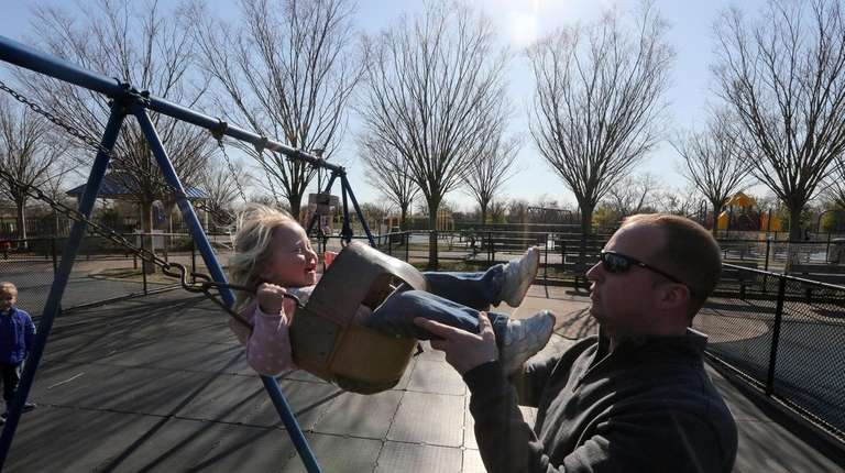 Tom Bloomfield, of Seaford, pushes daughter Kaley, 2,