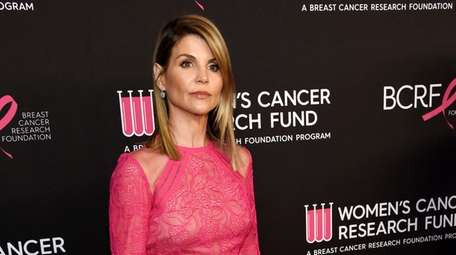 "Lori Loughlin poses at the 2019 ""An Unforgettable"