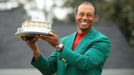 Tiger Woods celebrates with the Masters Trophy during
