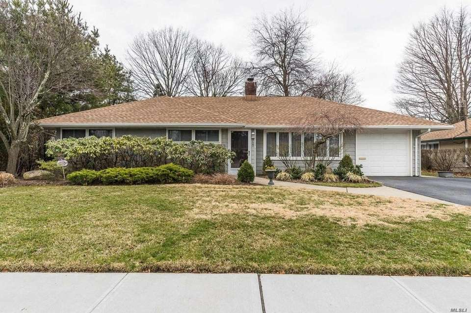 This Rockville Centre ranch includes four bedrooms and