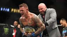 Dustin Poirier celebrates after recieving the interim lightweight