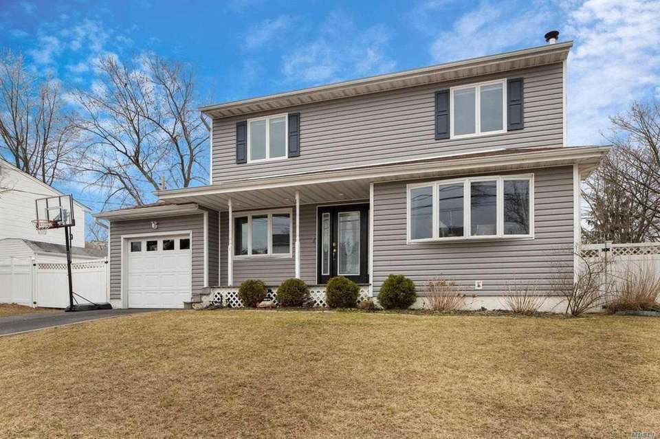 This Islip Terrace Colonial features four bedrooms and