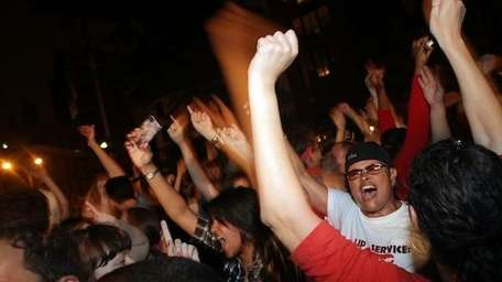 Revelers celebrate in front of the historic gay