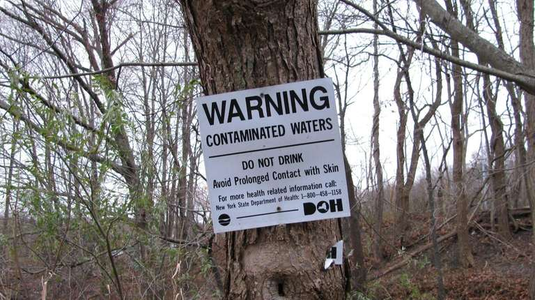 A sign at the Old Mill Creek, which