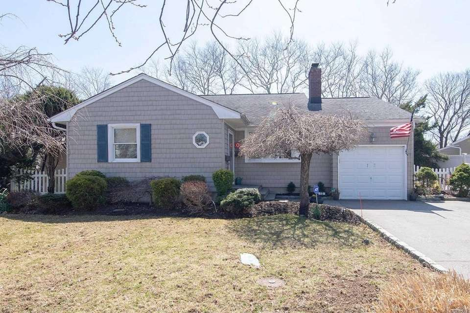This Syosset expanded ranch includes four bedrooms and