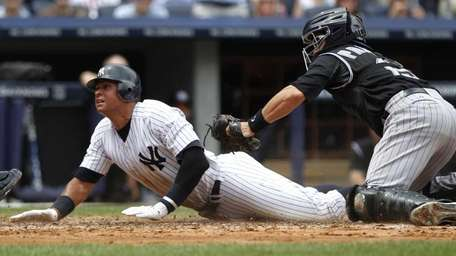 New York Yankees' Alex Rodriguez reacts after sliding