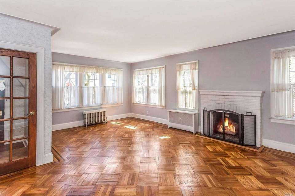 The house, with hardwood flooring throughout, includes a