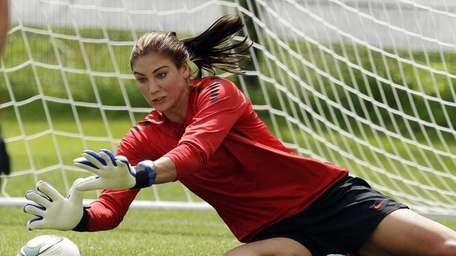 United States goalkeeper Hope Solo stops a shot