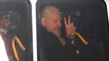 Julian Assange arrives at Westminster Magistrates' Court in