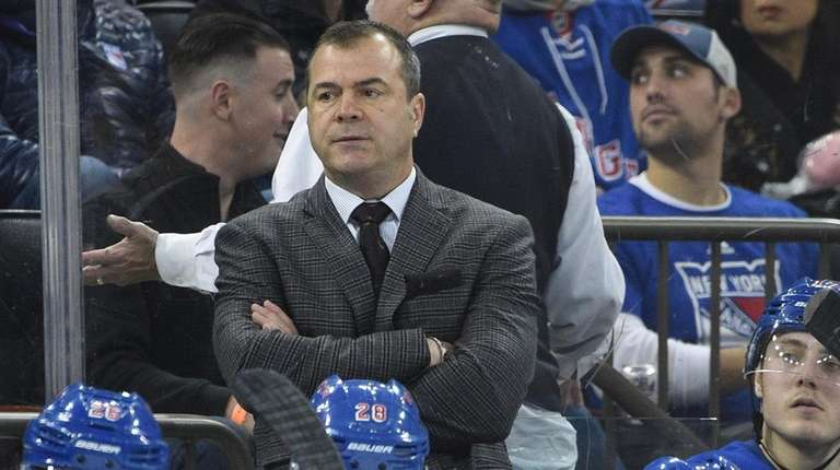 Alain Vigneault watches game action in the second