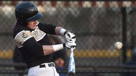 Anthony Foti #18 f Commack connects for an