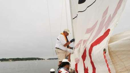 Sailing instructor John Leonowicz guides new sailors Marie