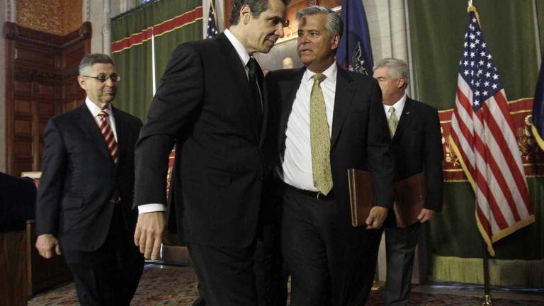 New York Gov. Andrew Cuomo, left, and Senate