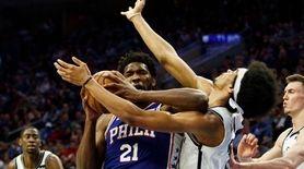Philadelphia 76ers' Joel Embiid, left, of Cameroon, with