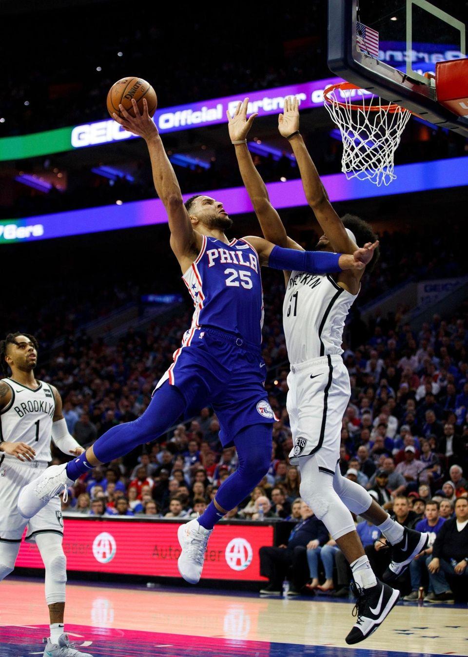 Philadelphia 76ers' Ben Simmons, left, of Australia, goes