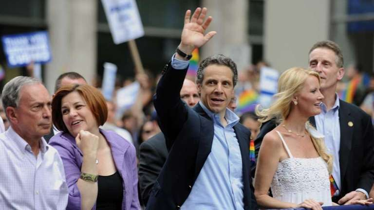 New York State Governor Andrew Cuomo walks with