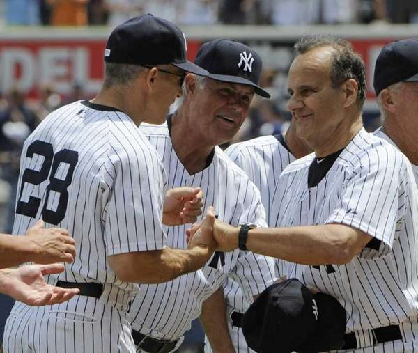 New York Yankees manager Joe Girardi, left, reacts